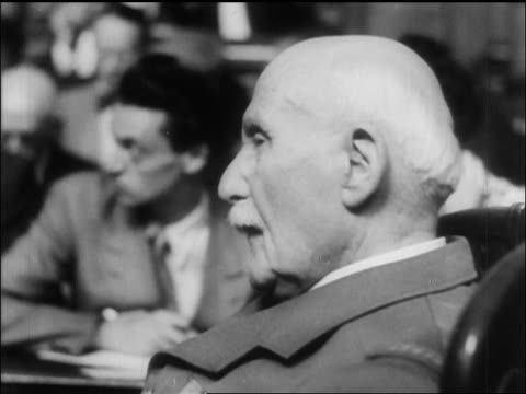 b/w 1945 close up profile petain sitting in courtroom during war crimes trial / newsreel - war crimes trial stock videos and b-roll footage