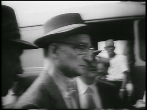 B/W 1957 close up PROFILE Soviet spy Colonel Rudolf Abel in hat eyeglasses outdoors / newsreel