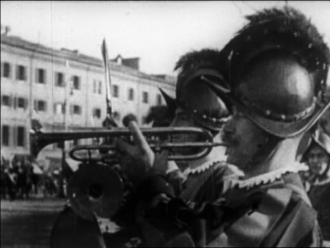 b/w 1929 close up profile swiss guard in uniform blowing coronet outdoors / vatican city / newsreel - swiss guard stock videos and b-roll footage
