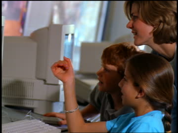 close up profile teacher + two students pointing to computer screen in classroom - profile stock videos & royalty-free footage
