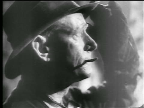 b/w 1942/43 close up profile weathered face of steel mill worker with cigarette in mouth / newsreel - newsreel stock videos & royalty-free footage