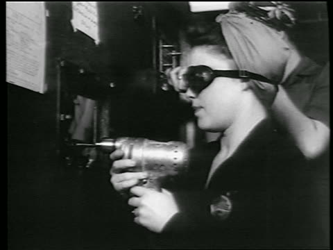B/W 1944 close up PROFILE woman with goggles kerchief on head riveting in defense plant / World War II