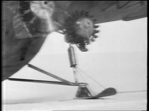 b/w 1929 close up propeller plane moving past camera on ground / antarctica - 1929 stock videos and b-roll footage