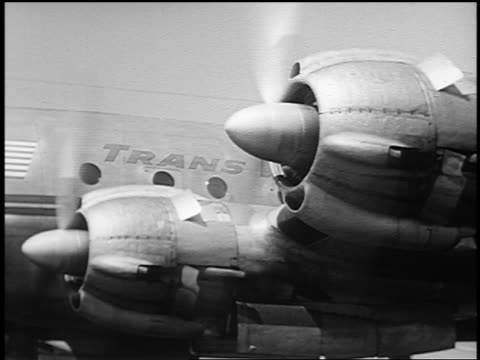 b/w 1951 close up propellers spinning on twa constellation airliner / midway airport, chicago - yorkville illinois stock videos & royalty-free footage