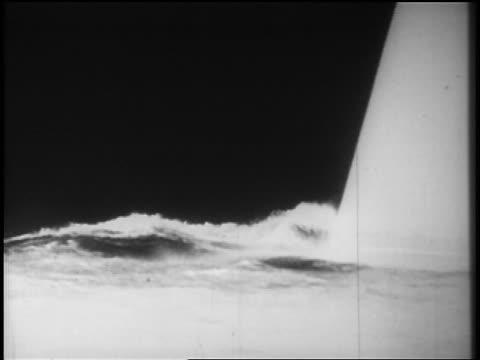stockvideo's en b-roll-footage met b/w 1928 close up prow of ocean liner sailing on ocean / newsreel - 1928