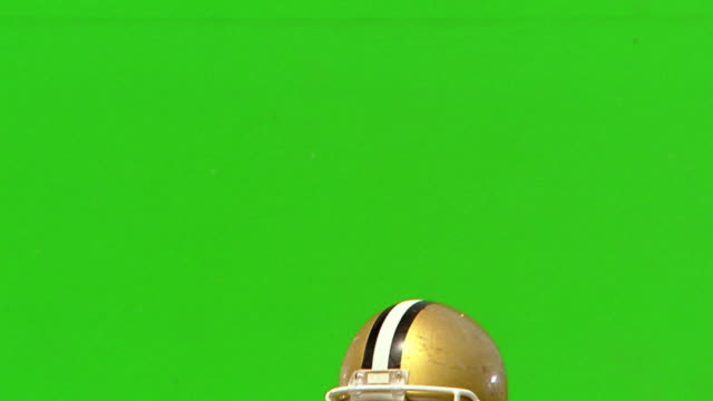 CHROMA KEY close up quarterback throwing football, punching fist in air + pointing / green background