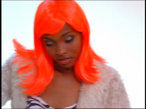close up rack focus black model in orange wig posing and smiling in photo studio with photographer's flashes - photo shoot stock videos & royalty-free footage