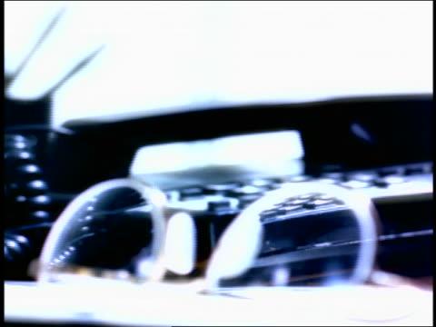vídeos de stock, filmes e b-roll de overexpososed close up rack focus man's hand picking up telephone / eyeglasses in foreground - superexposto