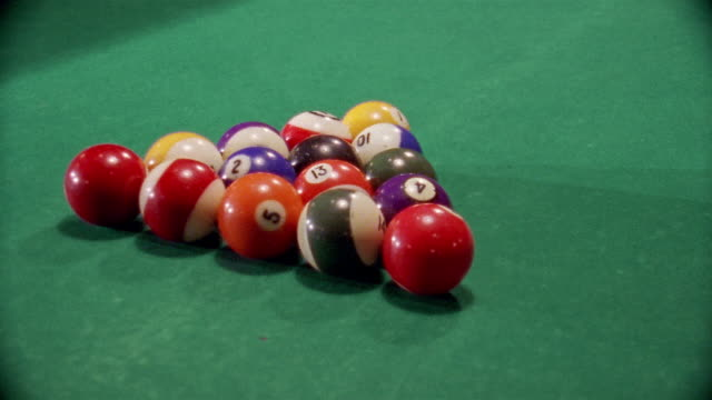 vídeos de stock e filmes b-roll de close up rack of pool balls / being hit by cue ball and breaking on pool table / san francisco - mesa de bilhar