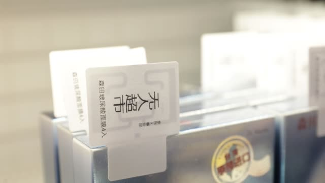 close up radiofrequency identification tags are attached to products displayed for sale at a jdcom inc unmanned convenience store inside the... - radio frequency identification stock videos & royalty-free footage