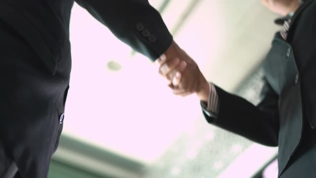 close up real time of asian business shaking hand. - formal stock videos & royalty-free footage