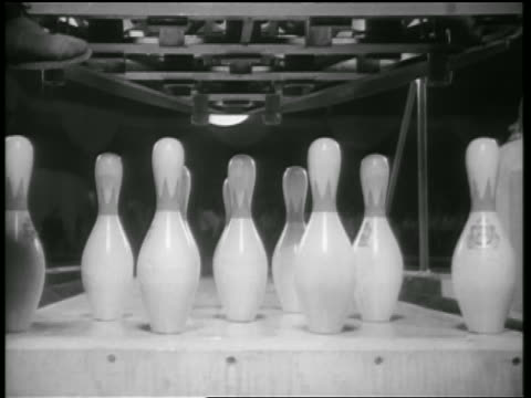 b/w 1938 close up rear view bowling ball knocking all pins down (strike) / chicago / newsreel - bowling ball stock videos & royalty-free footage