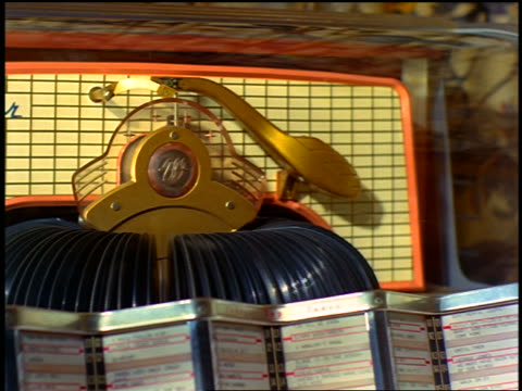 1963 close up records spinning around then one is chosen to play in jukebox - jukebox stock videos & royalty-free footage