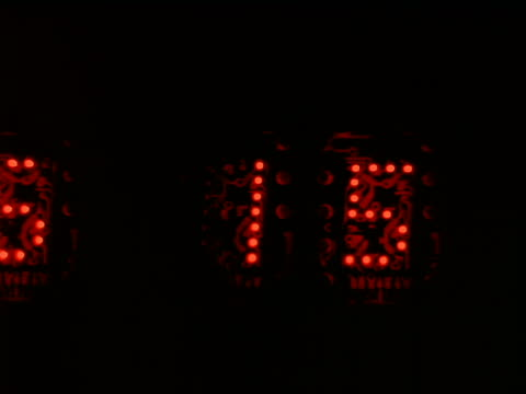 close up red digital numbers counting up on black background - stop watch stock videos & royalty-free footage