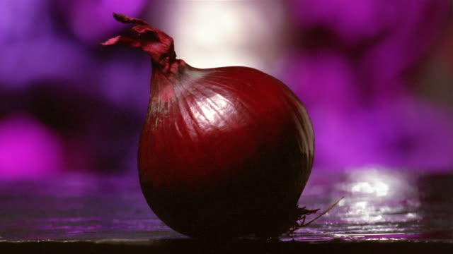 close up red onion being cut in half - red onion stock videos & royalty-free footage