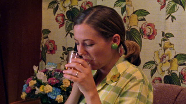 close up reenactment woman laughing, rolling eyes and drinking from glass while talking on telephone - rolling eyes stock videos & royalty-free footage