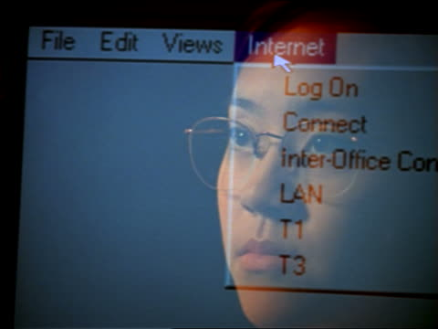close up reflection of asian woman with eyeglasses in computer screen moving arrow to menu bar - 1997 stock videos & royalty-free footage