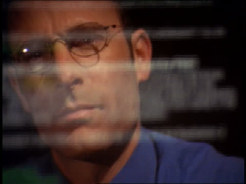 close up reflection of businessman wearing eyeglasses in computer screen with scrolling text - nur männer über 30 stock-videos und b-roll-filmmaterial
