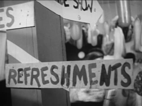 "B/W 1949 close up ""Refreshments"" sign attached to pole / people walking around in background / educational"