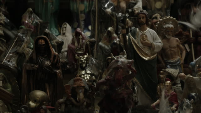close up, religious figurines at store in mexico - afterlife stock videos and b-roll footage