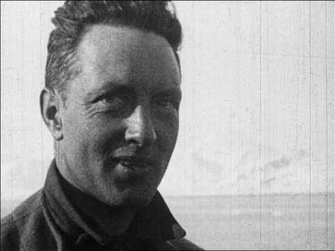 b/w 1926 close up richard e byrd talking smiling after flight over north pole / newsreel - one mid adult man only stock videos & royalty-free footage