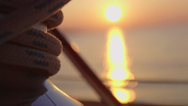 close up rigging rope on sailboat on tranquil sunset ocean, real time - rigging nautical stock videos & royalty-free footage