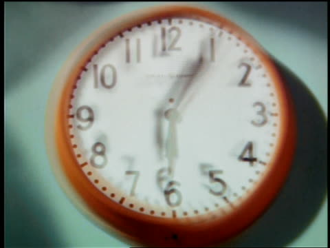 1964 close up rippled looking time lapse clock with hands moving counter-clockwise + coming in to focus - rückwärts fahren stock-videos und b-roll-filmmaterial