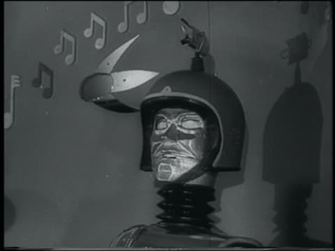 B/W 1958 close up robot with spinning radar on head moving mouth