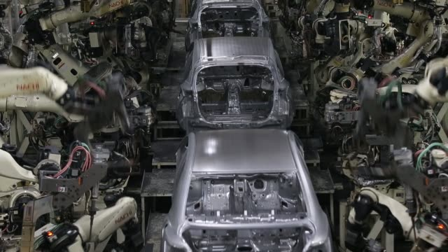 stockvideo's en b-roll-footage met close up robotic arms weld automobile body frames on the prius hybrid and prius hybrid plugin vehicle production line inside the toyota motor corp... - toyota motor