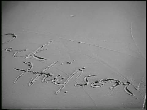 b/w 1956 close up rock hudson's signature in wet cement in front of grauman's / hollywood / newsreel - tcl chinese theatre stock videos & royalty-free footage