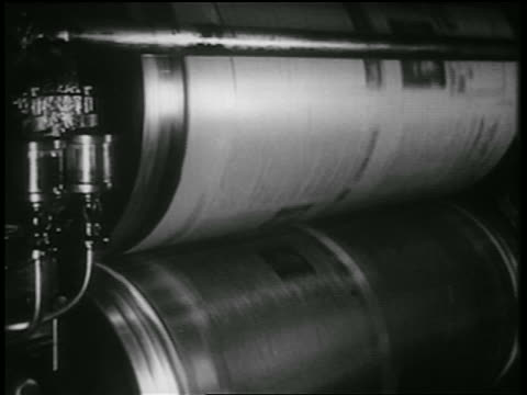b/w 1939 close up rollers of newspaper presses / documentary - printing plant stock videos & royalty-free footage