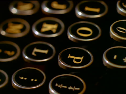 close up rotating tracking shot over old manual typewriter keyboard - typewriter keyboard stock videos & royalty-free footage