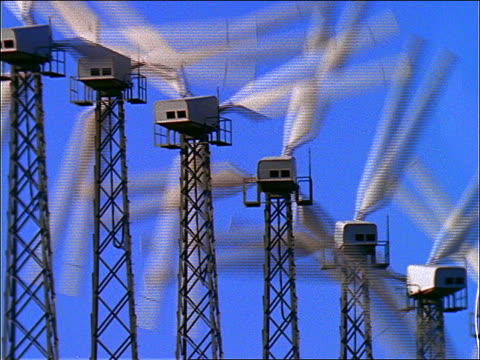 close up row of spinning wind turbines / california - cinematography stock videos & royalty-free footage