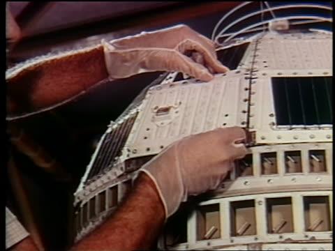 1962 close up rubbergloved hands attaching panel to telstar / doc - telstar stock-videos und b-roll-filmmaterial
