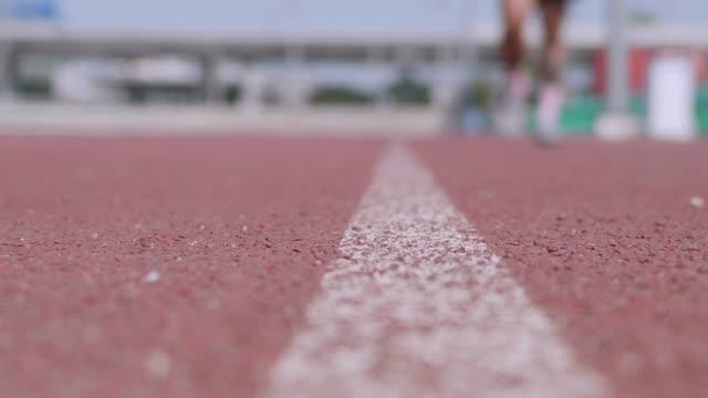 close up : runner feet running on track. - runner bean stock videos and b-roll footage