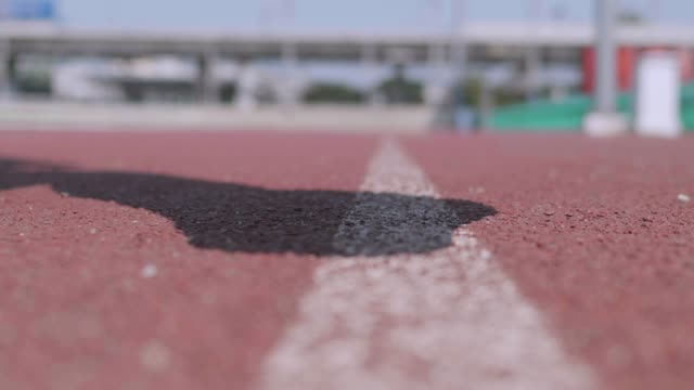 close up : runner feet running on track. - three wheeled pushchair stock videos & royalty-free footage
