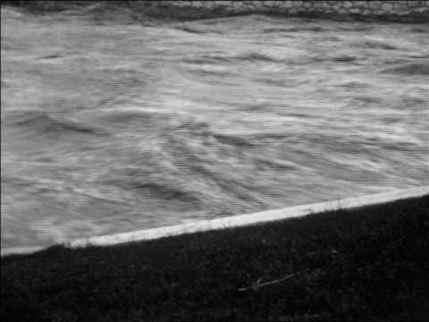 close up rushing flood waters / reno, nevada / newsreel - anno 1927 video stock e b–roll