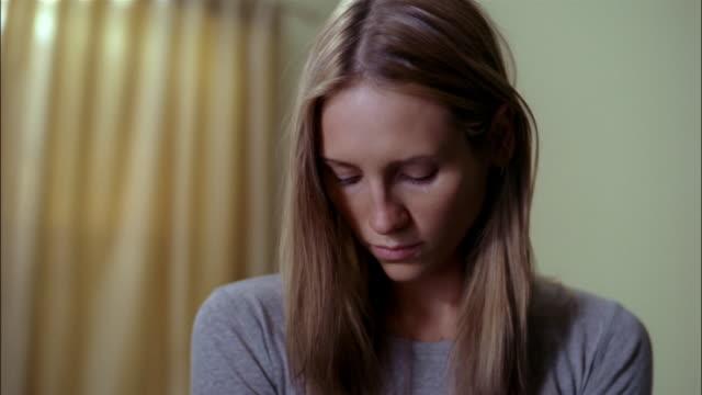close up sad woman looking down / looking at camera and looking away - sadness stock videos & royalty-free footage