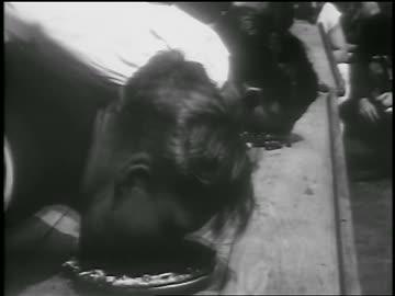 vídeos y material grabado en eventos de stock de b/w 1928 close up sailors eating in pie eating contest on ship / nyc / newsreel - concursante
