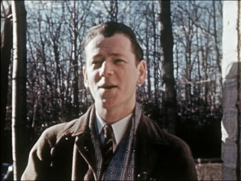 1941 close up salesman talking at open door - door to door salesperson stock videos & royalty-free footage