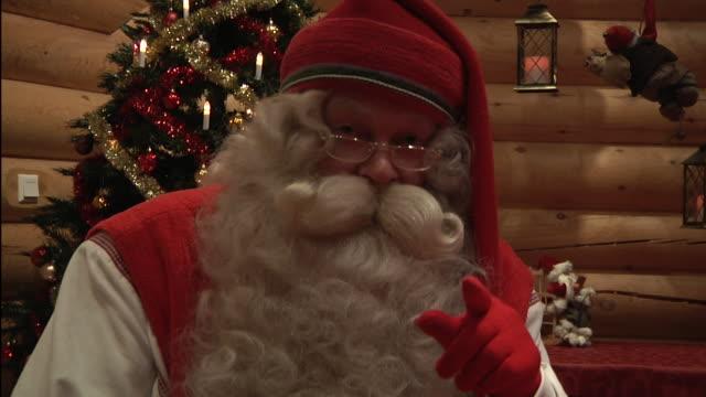 vídeos de stock e filmes b-roll de close up santa claus in his land of rovaniemi announcing his visit to all children shot on november 2010 - mamífero ungulado