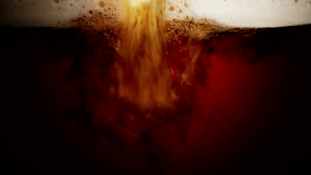 close up scene of pouring dark beer into glass - ale stock videos & royalty-free footage