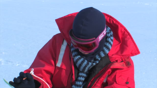 close up, scientist in snow goggles taking notes on the ice, in the arctic, september 23, 2008 – from the historic 17-month expedition involving 250... - arctic stock videos & royalty-free footage