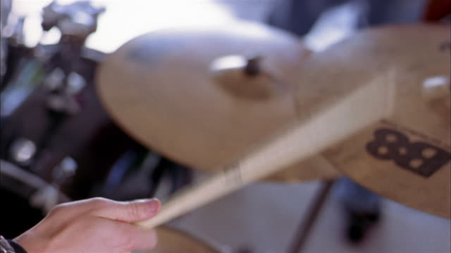 close up selective focus teenage boy playing drums - only teenage boys stock videos & royalty-free footage