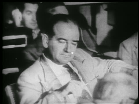 vidéos et rushes de b/w 1953 close up senator joseph mccarthy sitting in army hearings - 1953