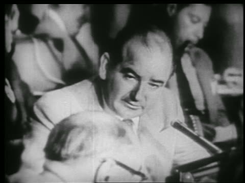 vidéos et rushes de b/w 1953 close up senator joseph mccarthy talks to someone beside him in army hearings - 1953