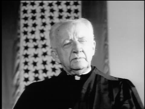 b/w 1943/44 close up senior clergyman talking / newsreel - religiöse kleidung stock-videos und b-roll-filmmaterial