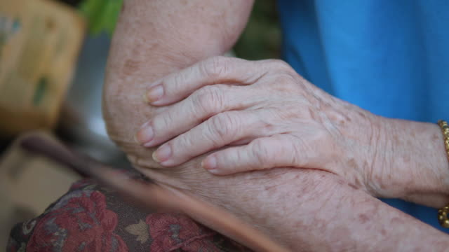 close up senior hand touching skin. - tendon stock videos & royalty-free footage