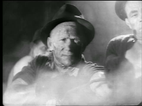 b/w 1942/43 close up senior man in hat struggling to pull something in steel mill / newsreel - newsreel stock videos & royalty-free footage