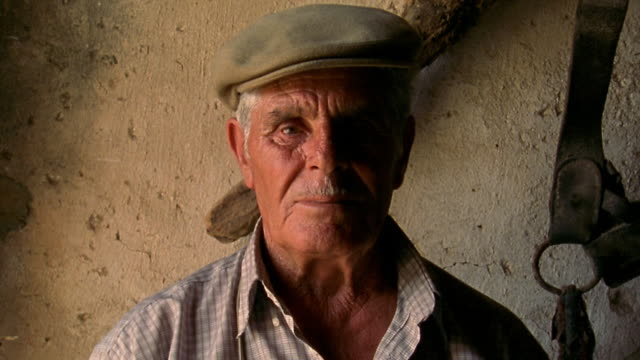 close up senior man looking serious indoors / custonaci, sicily - italian culture stock videos & royalty-free footage